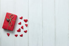 Gift boxes origami heart shape paper on wood background. Stock Photo