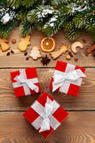 Gift boxes over christmas wooden background Royalty Free Stock Image