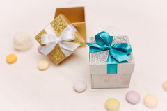Gift boxes over white wooden table with copy space Royalty Free Stock Image