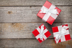 Gift boxes over wood table Royalty Free Stock Images