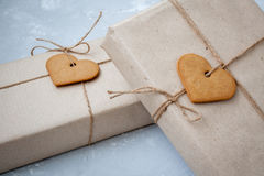 Gift boxes are packed in kraft paper Stock Photos