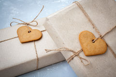 Gift boxes are packed in kraft paper Royalty Free Stock Photos