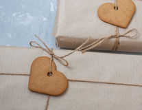 Gift boxes are packed in kraft paper Stock Image