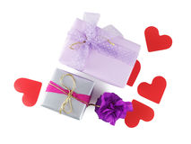 Gift boxes with paper hearts Stock Images
