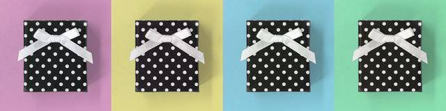 Gift boxes banner, on pastel multicoloured squares royalty free stock photos