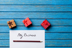 Gift boxes, pencil and paper with My Business words Royalty Free Stock Image