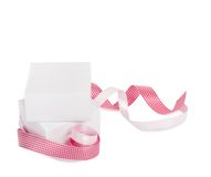 Gift boxes with pink ribbons on a white background Stock Photos