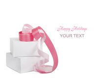 Gift boxes with pink ribbons on a white background Royalty Free Stock Photography