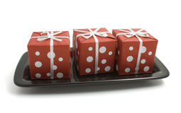 Gift boxes on a plate Royalty Free Stock Photography