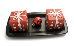 Gift boxes on a plate Stock Photos