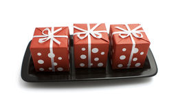 Gift boxes on a plate Stock Photography