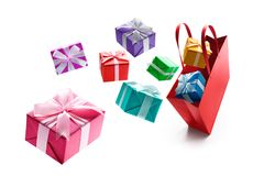 Gift boxes pop out from red shopping bag Stock Photography