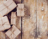 Gift boxes, postal parcels on wooden board Stock Photography
