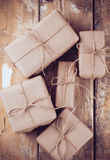 Gift boxes, postal parcels on wooden board royalty free stock photography