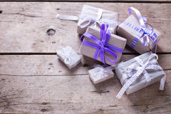 Gift boxes with presents on aged wooden background. Royalty Free Stock Photos