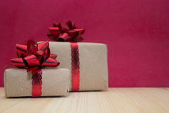 Gift boxes on red background Stock Photos