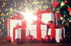 Gift boxes and red balls under christmas tree Royalty Free Stock Photography