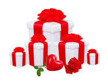 Gift boxes with red bow and red rose isolated on white Stock Images