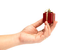 The gift boxes red & gold color in hand give for you on white background. Isolated, Christmas holiday and party decoration Stock Photography