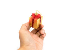 The gift boxes red & gold color in hand give for you on white background Royalty Free Stock Photography