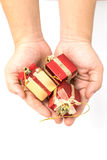 The gift boxes red & gold color in hand give for you on white background. Isolated, Christmas holiday and party decoration Royalty Free Stock Photography