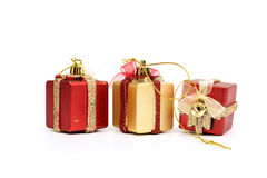The gift boxes red & gold color on white background Royalty Free Stock Photos