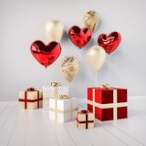 Gift boxes with red and golden glossy 3d realistic balloons in heart shape with stick. Valentine`s Day or wedding day romantic themes for party, events Stock Photo