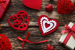 Gift boxes, red hearts and bow Stock Image