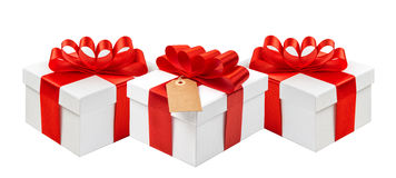 Gift boxes red ribbon bow decoration isolated white background Stock Images