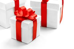 Gift boxes with red ribbon bow isolated on white background stock photos