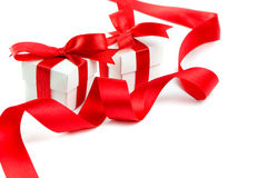 Gift boxes. With red ribbon and bow on white background, with copy space stock photos
