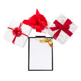 Gift boxes with red ribbon and gift list on white background Royalty Free Stock Image