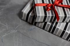 Gift boxes with a red ribbon royalty free stock photo