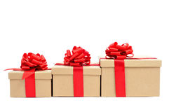 Gift boxes with red ribbon. Some gift boxes tied with red ribbon on a white background Royalty Free Stock Photo