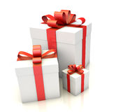 Gift boxes with red ribbon on white floor Royalty Free Stock Photos