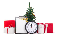 Gift boxes with red ribbon, wish list, christmas tree and clock Stock Image