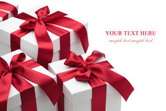 Gift boxes with red ribbons and bows. royalty free stock photography