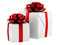 Gift boxes with red ribbons isolated on white Royalty Free Stock Photo
