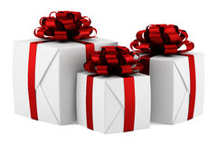 Gift boxes with red ribbons isolated on white Stock Photography