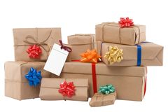 Gift boxes with ribbon and blank label Royalty Free Stock Photos