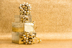 Gift boxes with ribbon bow. Holidays decoration. Greetings card. Gift boxes with ribbon bow on golden shiny background. Holidays decoration. Greetings card Royalty Free Stock Images