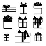 Gift boxes with ribbon bows icons set isolated over white. Christmas gift box in monichrome style. Vector illustration Royalty Free Stock Photo