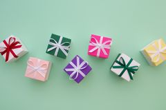 Gift boxes with ribbons on pastel green background. Top view, fl Stock Photography