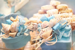 Gift boxes with ribbons, shells and cookies Royalty Free Stock Photos