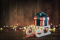 Gift boxes with ribbons on sled Stock Photography