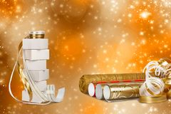 Gift boxes and rolls of wrapping paper Stock Images