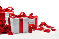 Gift boxes with rose petals. On white background royalty free stock images