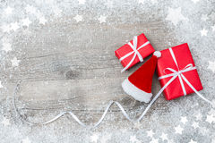Gift boxes and Santa's hat Royalty Free Stock Photos