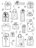 Gift boxes set. Hand drawn vector sketch. Set of gift boxes. Hand drawn vector sketch of gift boxes, presents for birthday, anniversary, wedding design Stock Image