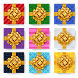 Gift boxes set top view vector illustration. Gift boxes set with golden ribbon bow top view vector illustration. Beautiful colorful realistic present boxes Royalty Free Stock Photo